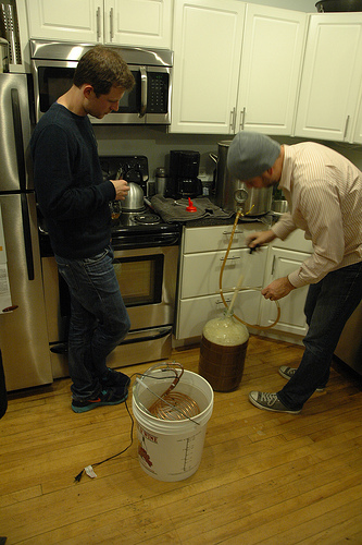 photo of two mightybytes team members brewing beer