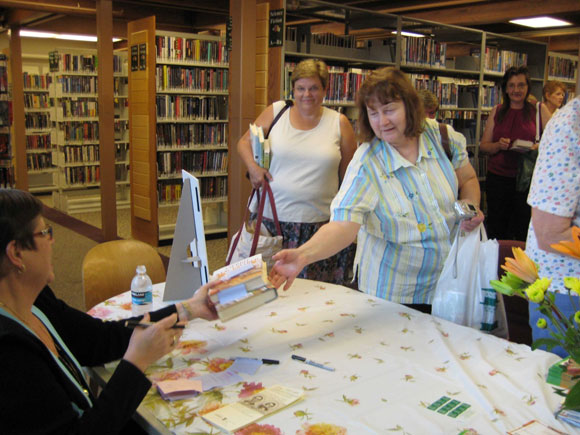 photo of women at niles library handling books