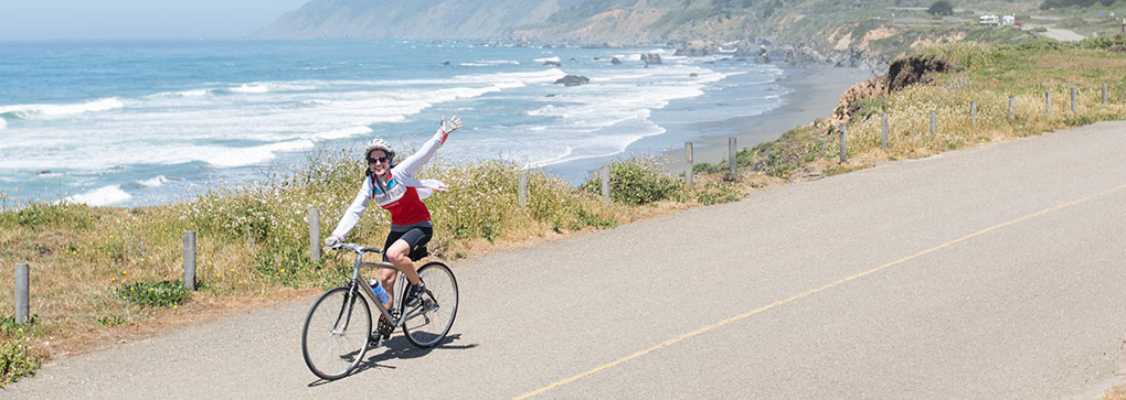 Climate Rider pedaling along the coastline