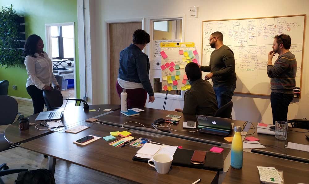 How Might We exercises during day one of a Design Sprint