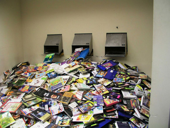 photo of a huge pile of returned dvds and books