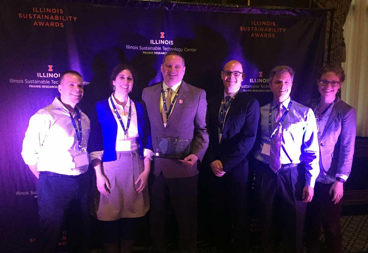 Folks from the Mightybytes team posing glamorously with the Illinois Sustainability Award.