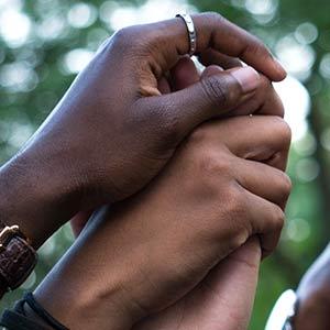 hands held in solidarity