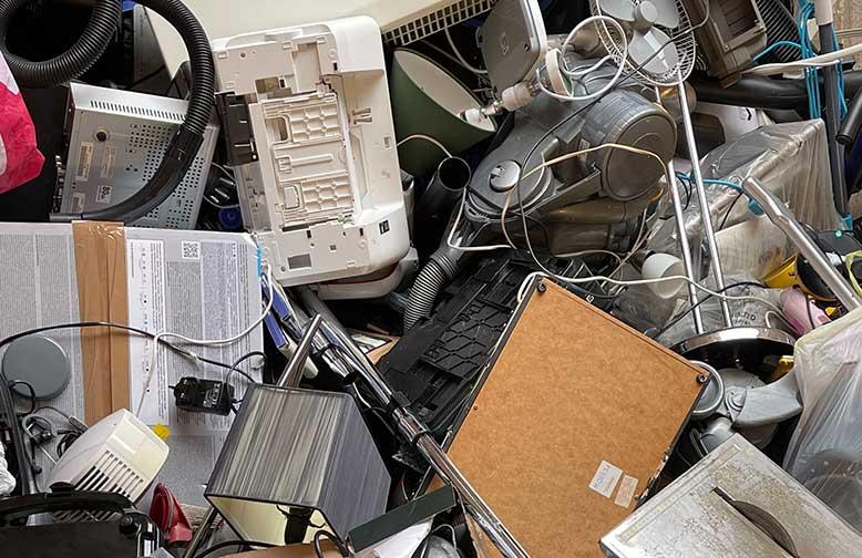 image of electronic waste (e-waste) piling up